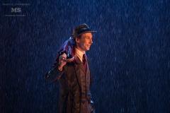 Поющие под дождём